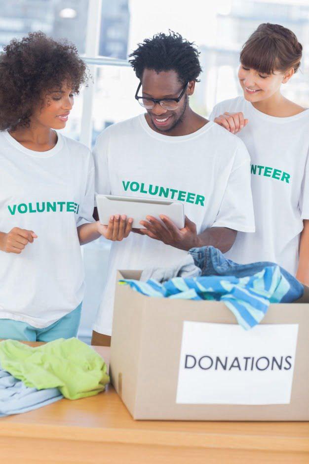 cheerful volunteers looking tablet pc 13339 135775